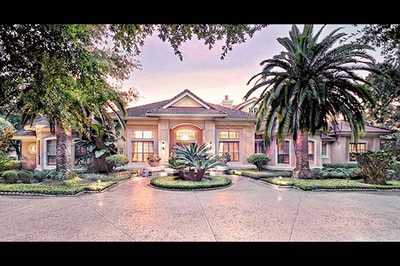 Elegant Estate Isleworth Front View with Sunset