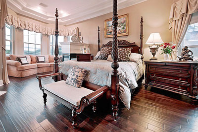 Luxury Estate Kissimmee Elegant Bedroom with Sitting Area and Fireplace